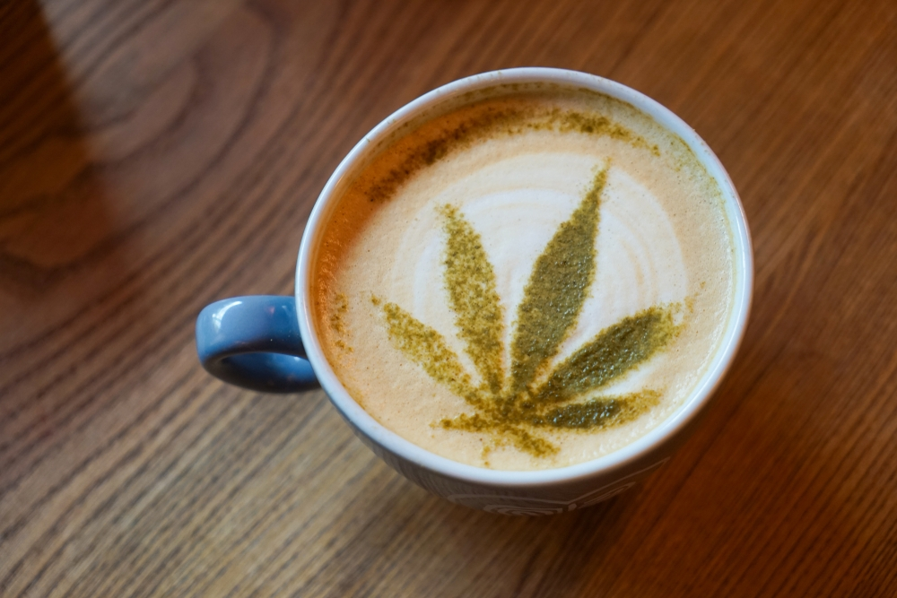 cappucino wih latte art in form of a cannabis leaf