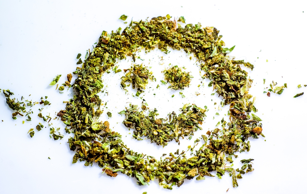 smiling face made of cannabis plant